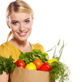 woman holding a shopping bag full of groceries, mango, salad,  r