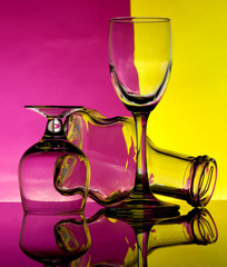 Glass goblets on a colored background