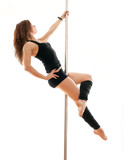 The young beautiful woman hangs on a pole