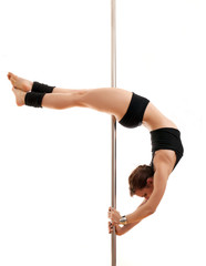 The beautiful sports woman and dancing pole