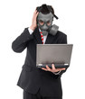 concerned business man with gas mask holding laptop