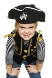 Grinning little girl wearing pirate costume