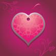 Ornamental heart on the purple background