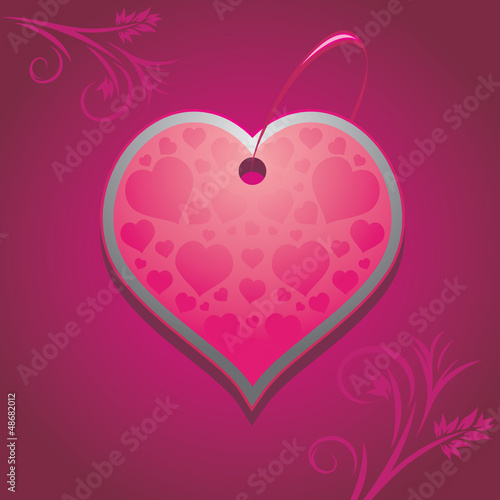 Ornamental heart on the purple background