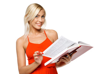 Smiling woman in red dress turning the pages of book
