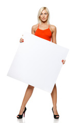 Calm woman in full length holding empty banner