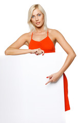 Woman leaning at empty whiteboard, pointing at it