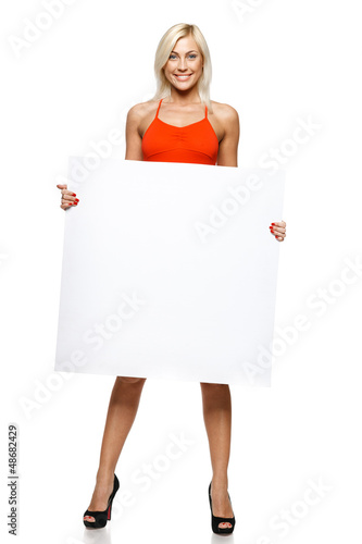 Smiling woman in full length holding empty banner