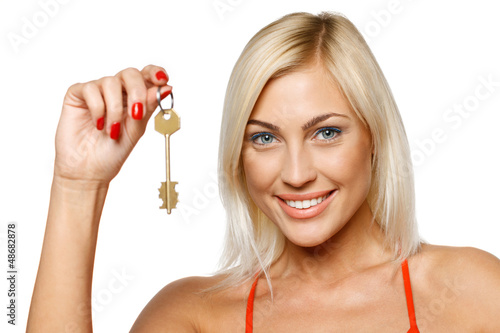 Closeup portrait of  pretty young lady holding a key