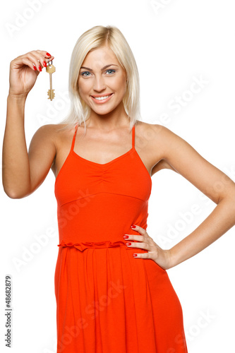 Bright picture of pretty young lady holding a key