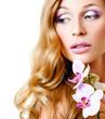 long-haired blonde with pink orchids