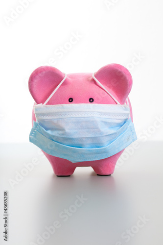 Piggy Bank with Face Mask - Swine Flu Concept
