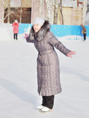 Beautiful woman is skating outdoor