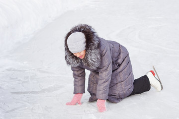 Woman fell on the ice rink