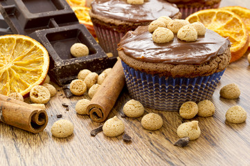 chocolate muffin with amaretti, oranges and cinnemons