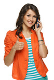 Woman talking on cellphone showing thumb up sign