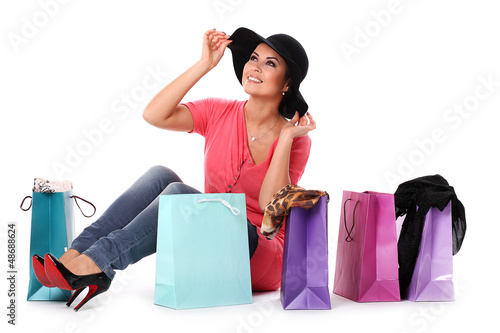 Young happy woman enjoys shopping