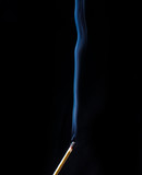 Fireless match and smoke wave on black background