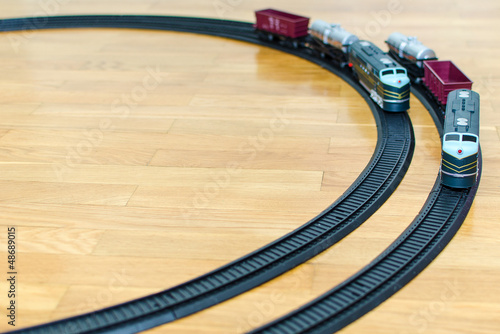 Two toy trains on wooden floor