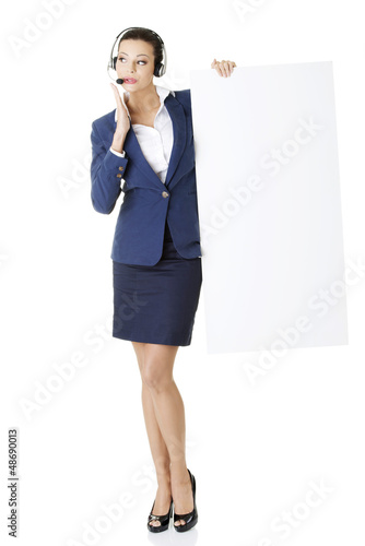 Call center worker holding blank board