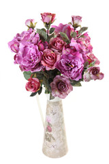 bouquet of artificial roses in a vase on a white background