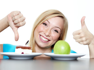Woman shows thumb up for fruits, thumb down for sweets