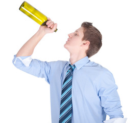 Casual young business man  drinking bottle of wine