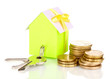 Small house with money and key isolated on white