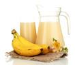 Full glass and jug of banana juice and bananas isolated on
