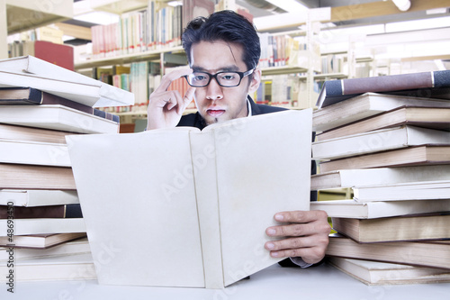 Busy businessman at library