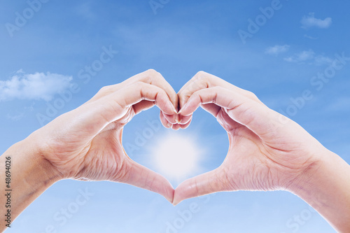Hand gesture of love and sun