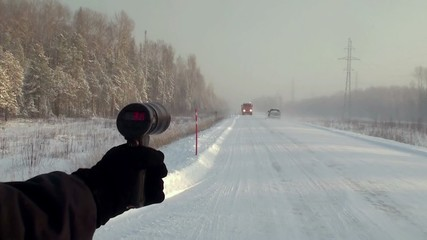 Police radar gun in use at winter auto road. Siberia, Russia.