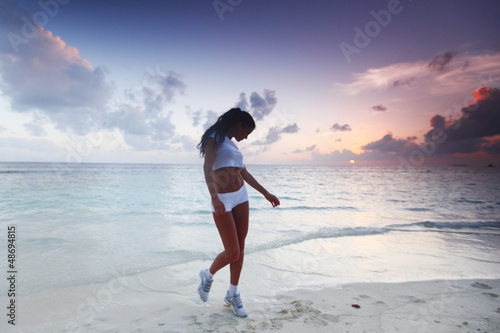 Woman in sportswear on beach