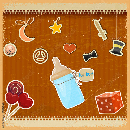 Vintage background with baby's bottle of milk and toys