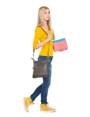 Teenage student girl with books going sideways