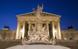 Vienna - Pallas Athena fountain and parliament in winter evening