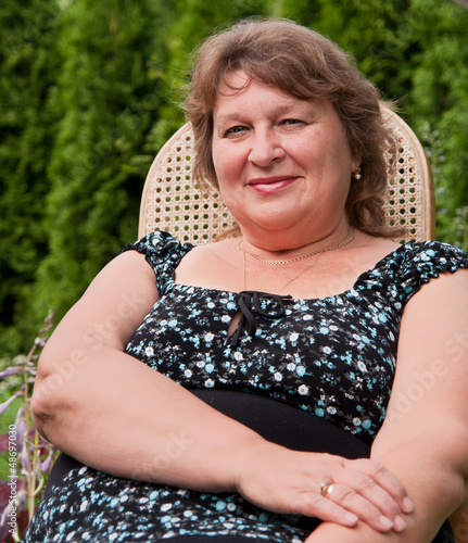Middle-aged woman relaxing on a bench