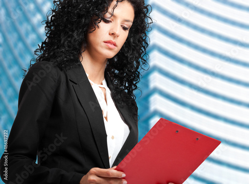 Businesswoman reading some documents