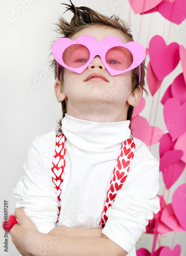 Boy in pink glasses
