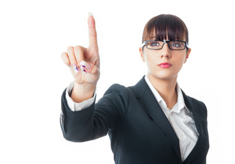 Businesswoman touching an invisible screen against