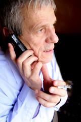 Elderly businessman talking to phone