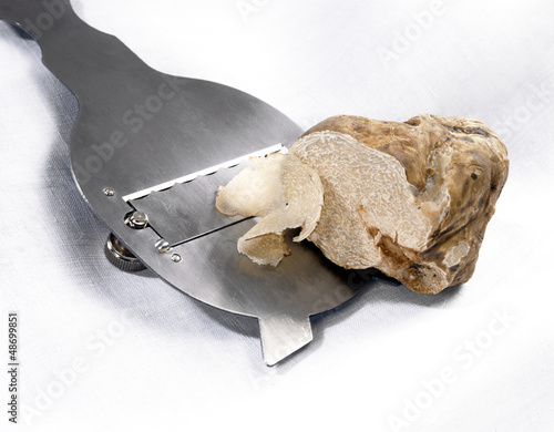 Slicing a white truffle