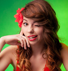 Portrait of a beautiful, playful young woman winking