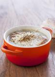 Onion soup in orange cocotte