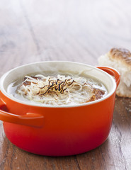 Onion soup in orange cocotte