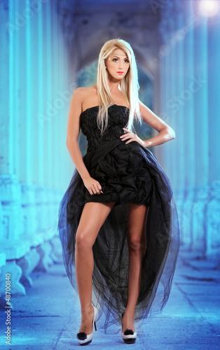 Beautiful sexy woman in black dress posing outdoor