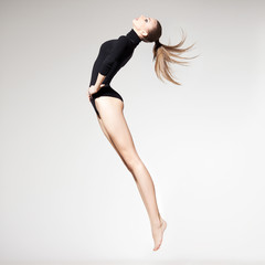 beautiful woman with perfect slim body and long legs jumping