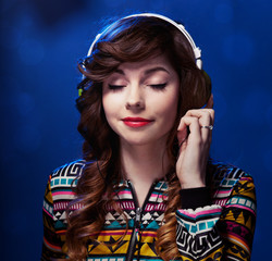 Girl with headphones enjoying music