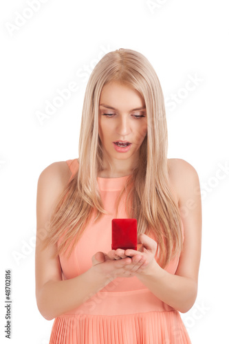 Surprised blond woman with ring in box