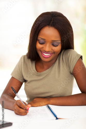 happy african famale college student studying